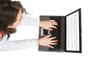 casual woman browsing on laptop from the top